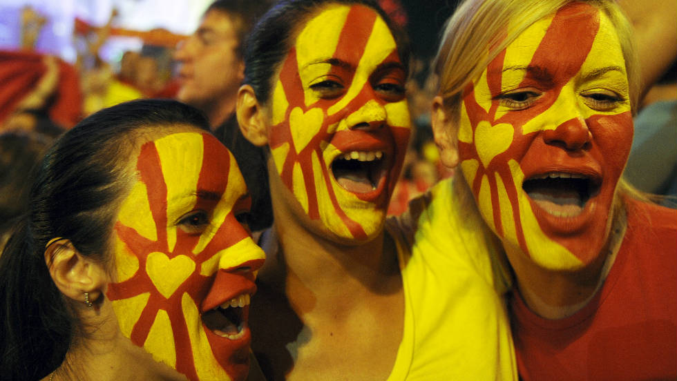 Young women in Skopje show their true colours by painting their faces in the colors of the Macedonian flag