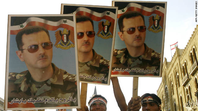 Syrian regime supporters carry pictures of President Bashar al-Assad in Beirut on September 8, 2011.