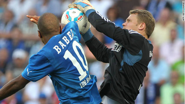Bayern Munich keeper Manuel Neuer claims the ball from Hoffenheim striker Ryan Babel.