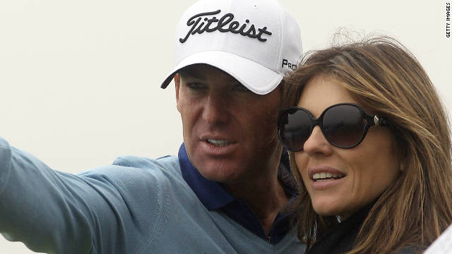 Shane Warne and Elizabeth Hurley watch the action during the third round of The Alfred Dunhill Links Championship.