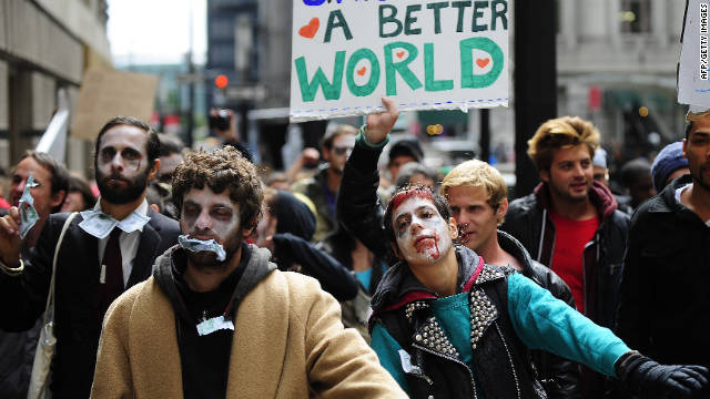 "Demonstrators with ""Occupy Wall Street"" participate in a march dressed as ""corporate zombies"" in New York on Monday, October 3."