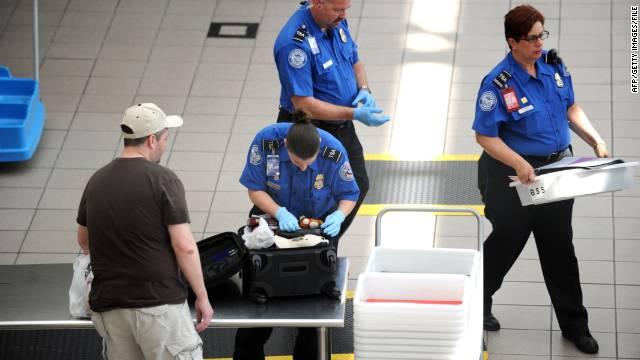 A TSA agent checks a bag on May 2, 2011, at Orlando International Airport.