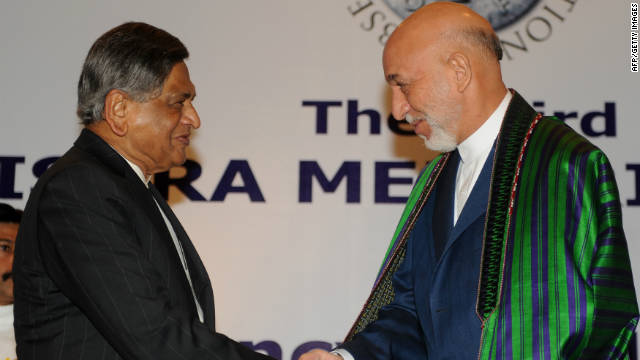 Afghan President Hamid Karzai, right, greets Indian Foreign Minister S.M. Krishna in New Delhi on Wednesday.