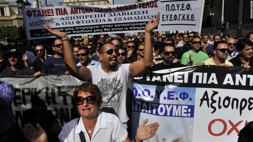 Protesters march toward the Greek Parliament shouting slogans against their government and the group overseeing Greece's $146 billion bailout: the European Central Bank, European Commission and International Monetary Fund.