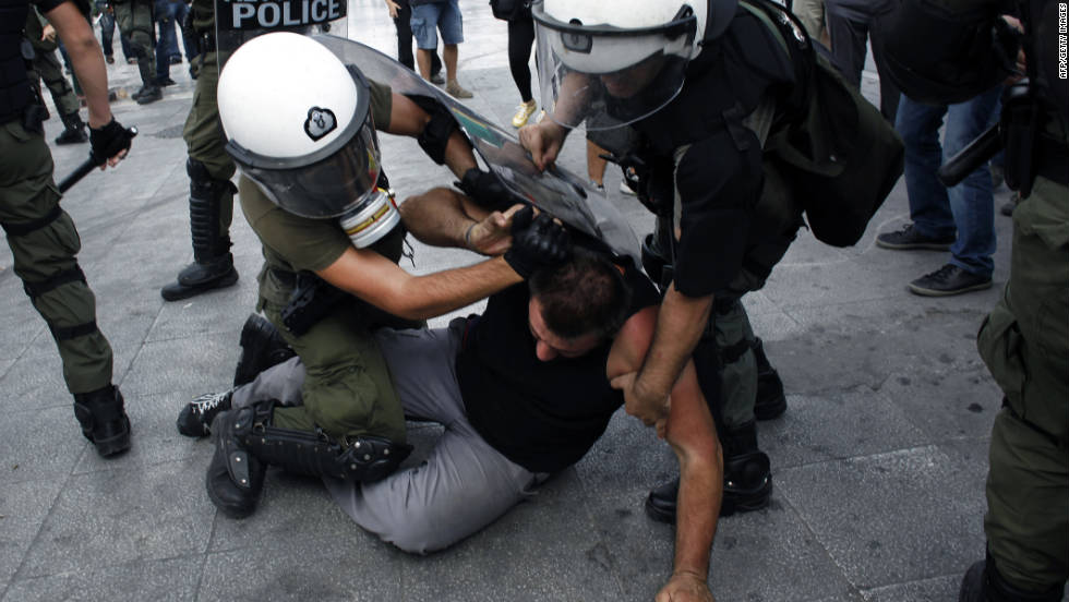 A demonstrator is arrested in Athens during a protest rally last October against austerity cuts imposed to tackle Greece's debt crisis