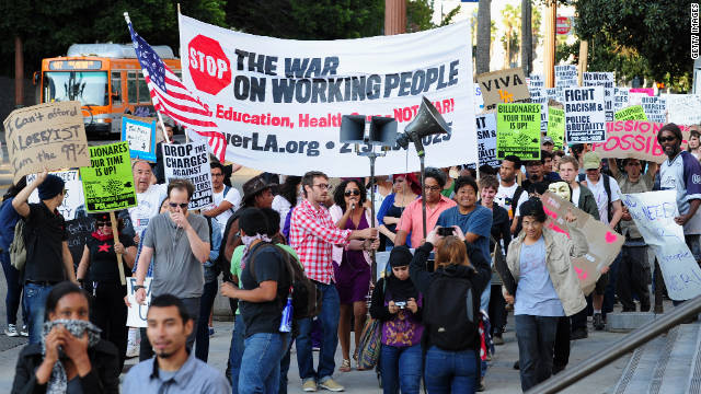 Occupy Wall Street protests are taken up in Los Angeles, as demonstrators march through downtown October 3.