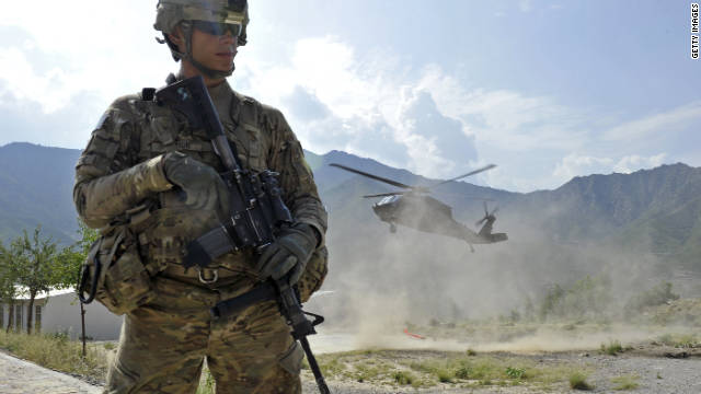 A U.S. soldier secures a landing zone for a Black Hawk helicopter in the Shigal district center in Kunar province, Afghanistan.