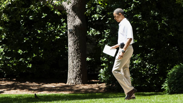 President Obama carries an iPad at the White House in May.