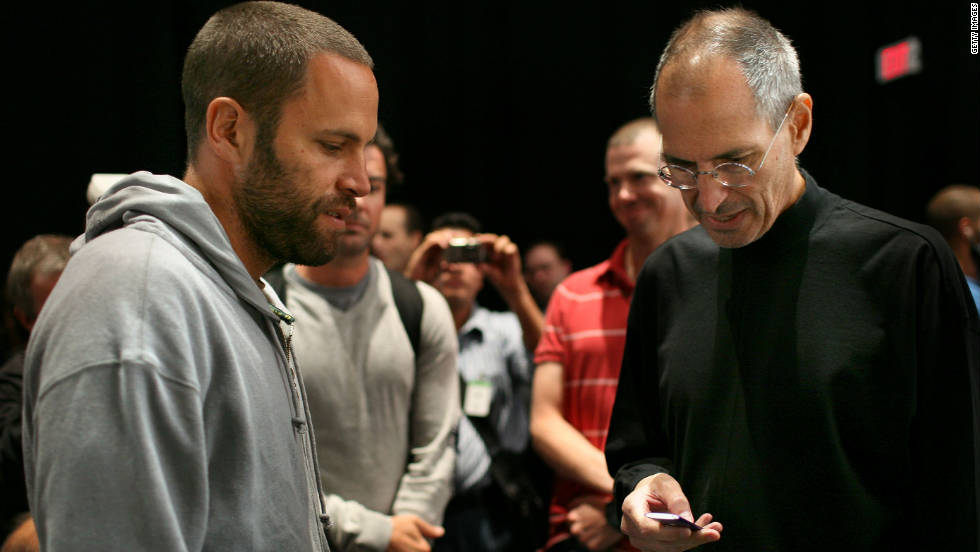 """Musician Jack Johnson, left, talks with <a href=""""http://www.cnn.com/specials/tech/steve-jobs-the-man-in-the-machine"""">Jobs</a> during an Apple special event in 2008 where a new version of the iPod Nano and Touch were announced."""