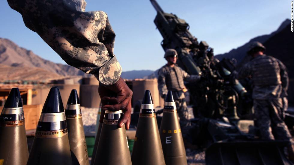 Artilerymen await coordinates before firing a 155-mm Howlitzer from Camp Blessing in the Kunar province of eastern Afghanistan on October 22, 2008. Their unit, Charlie Battery, 3rd Battalion of the 321 Field Artilery, is the busiest artilery unit in the U.S. Army, according to military officers.