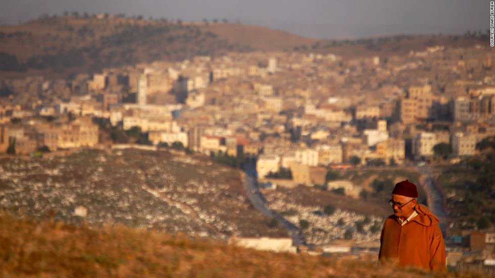 Marc Burba shared a beautiful perspective shot of a man climbing up Borj Nord Hill with Fez in the background.