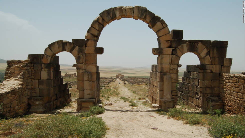 "iReporters share photos they captured of Morocco's majestic beauty during their adventures. Marc Burba took this photo of a stone archway  that leads to the main road of Volubilis. These Roman ruins are a UNESCO World Heritage site. ""It was sunny and extremely hot, but because of that we had this amazing site almost all to ourselves."""