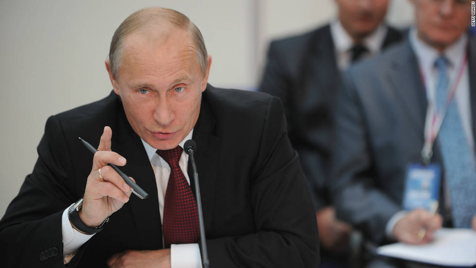 Russia's Prime Minister Vladimir Putin meets the visiting FIFA inspection team in Moscow. Qatar is the last country to receive the inspectors in September.