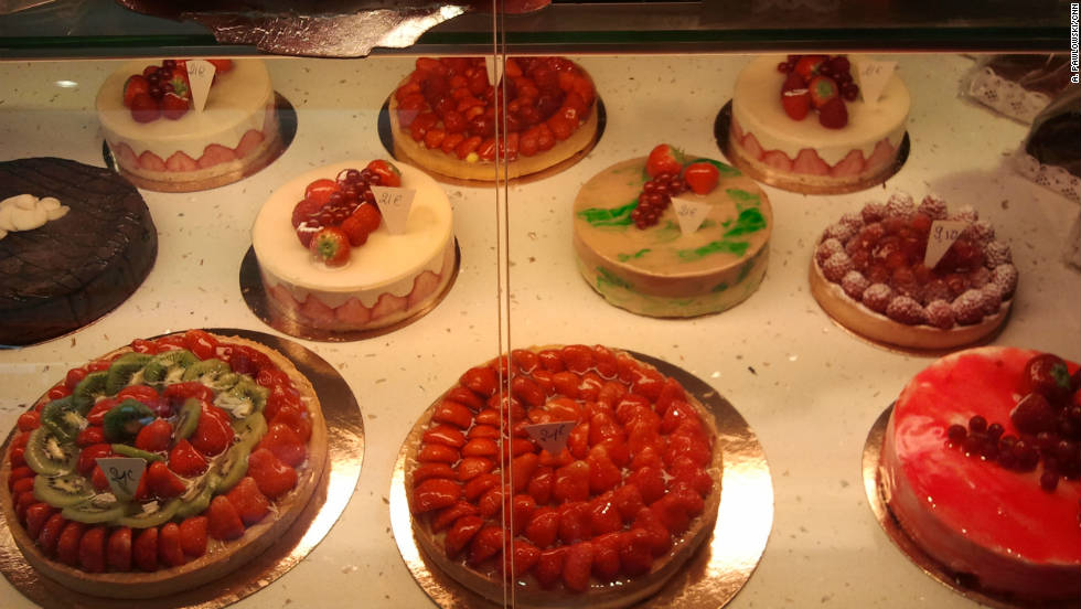 Tempting cakes for sale at the bakery on Rue Cler.