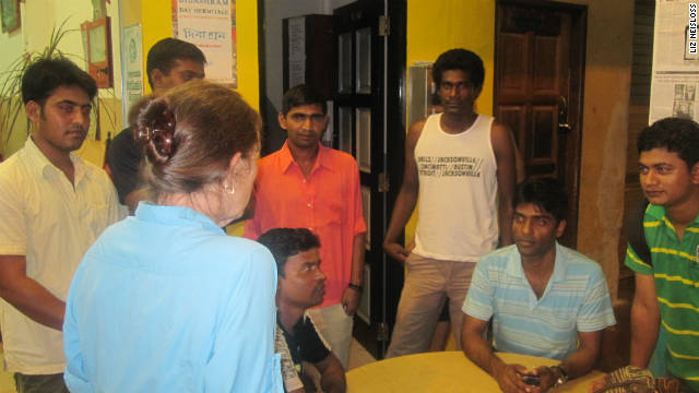 Debbie Fordyce talks with migrant workers seeking assistance through her Cuff Road Project.