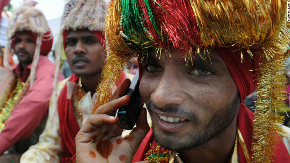 An Indian talks on his mobile phone during a mass marriage ceremony for some 525 poverty-stricken couples from the India-Pakistan border area  on April 13, 2009.