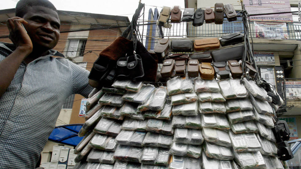 A vendor of mobile phones in Lagos, Nigeria, in April 2007. The cost of cell phones have dropped in the past decade, which saw mobile subscriptions grow to 4 billion in the developing world.