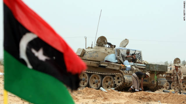 Libyan fighters loyal to the National Transitional Council (NTC) during fighting in the town of Sirte on October 8, 2011.
