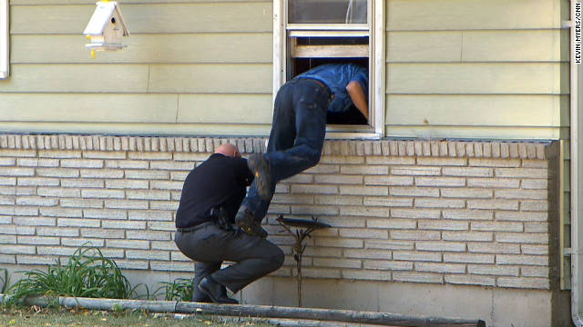 Kansas City police seach the Irwin family home on Sunday.