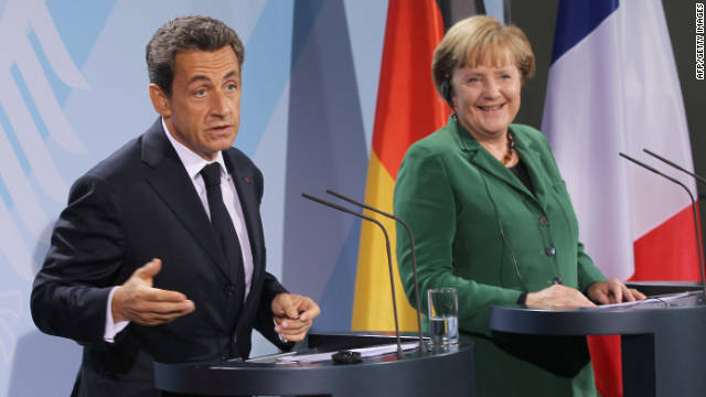 French President Nicolas Sarkozy and German Chancellor Angela Merkel speak to the media after meeting in Berlin on Sunday, October 9.