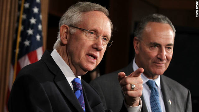 Sens. Harry Reid, left, and Charles Schumer are backing a surtax on the income of people who earn more than $1 million.
