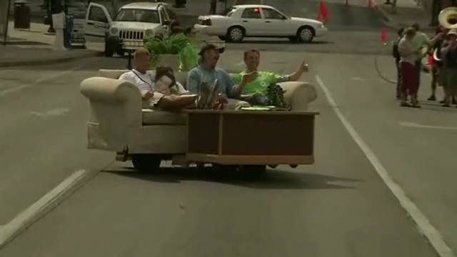 Moving couch part of 'Sedentary Parade'