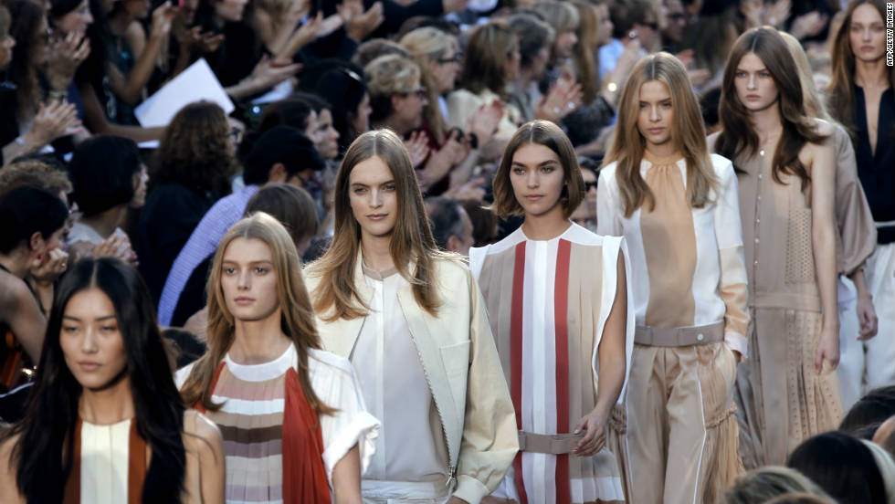 Models present creations by British designer Clare Waight Keller for Chloe on October 3 in Paris. Expect to see loose layers, creams and whites in picked up by retailers in malls and high-street stores.