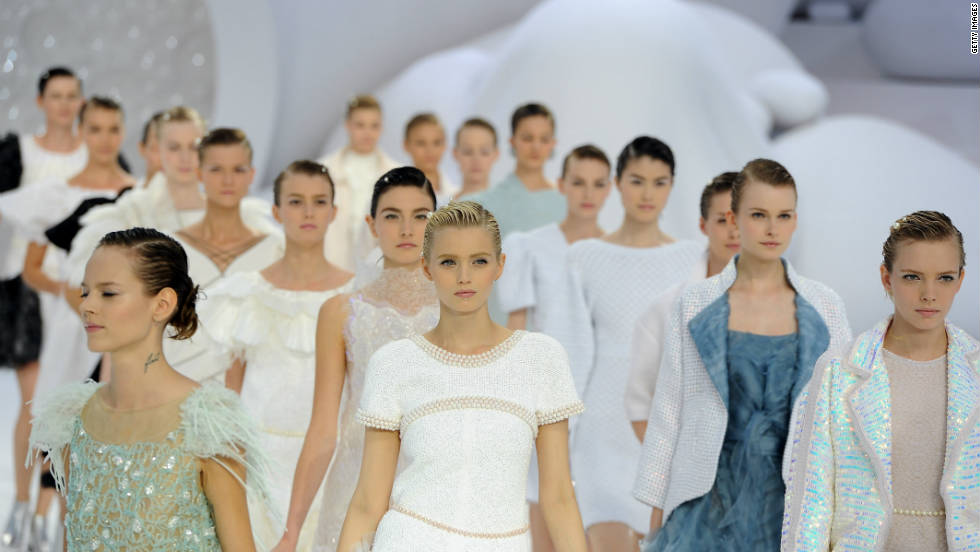 Fashion will be frothy, frilly and feminine next season. Models walk the runway during the Chanel Ready-to-Wear Spring/Summer 2012 show during Paris Fashion Week at the Grand Palais.