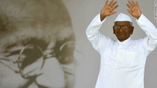 Anna Hazare gestures to supporters as he walks on-stage in New Delhi, in August.
