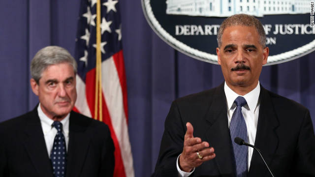 U.S. Attorney General Eric Holder and FBI Director Robert Mueller, left, announce the foiling of a terror plot Tuesday.