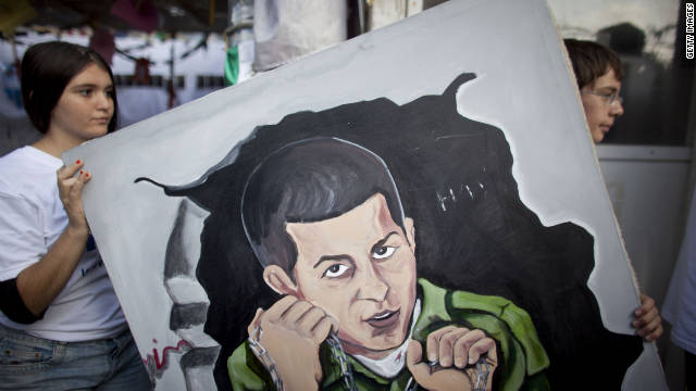 Supporters of the release of IDF soldier Gilad Shalit dismantle a protest tent outside the prime minister's residence in Jerusalem.