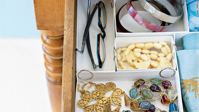 Jewelry boxes keep desk drawers tidy.