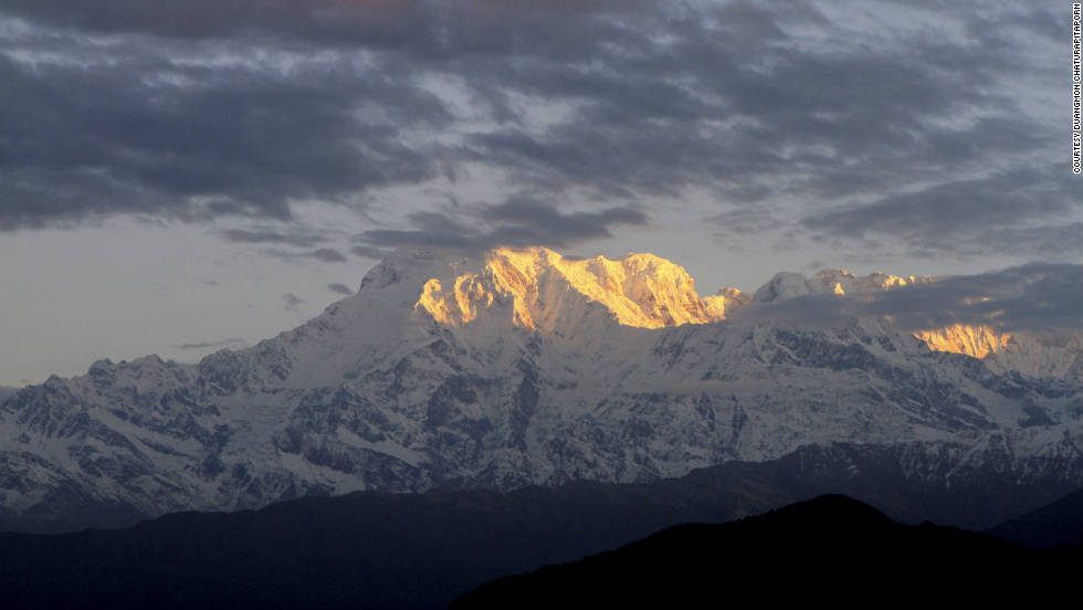 """When the first sunlight hit the Himalayas, I was captured by the soft golden color of the first sunrise,"" says iReporter Duangmon Chaturapitaporn."