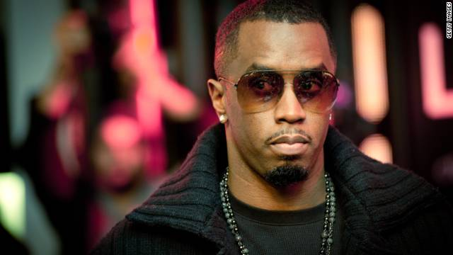"Diddy signs copies of his single ""Coming Home"" in London on January 20, 2011"