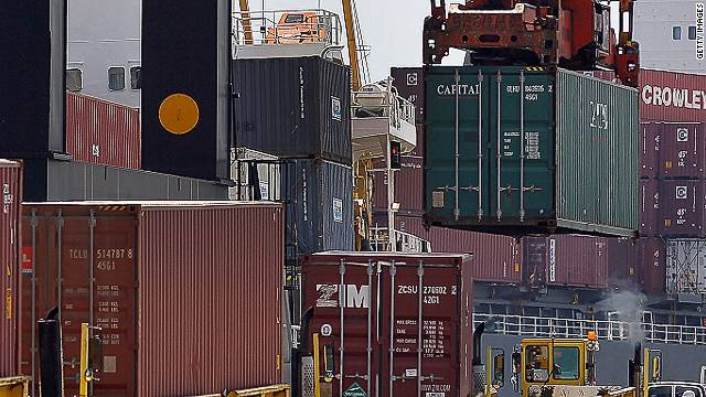 Longshoremen load shipping containers in Florida on Wednesday as lawmakers passed three free-trade agreements.