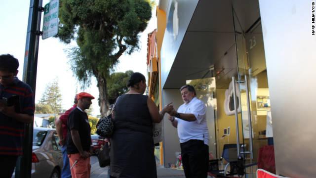 Steve Wozniak autographed fans' Apple products outside the Los Gatos store.