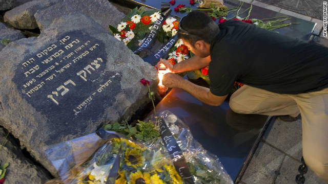 An Israeli man lights a candle at a memorial site for late prime minister Yitzhak Rabin in Tel Aviv on October 20, 2010.