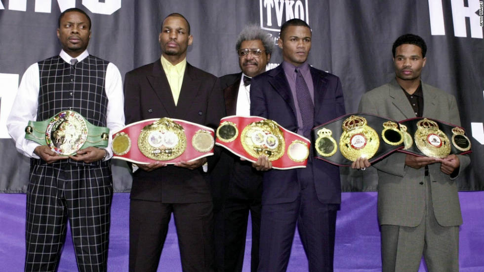 Hopkins (second from the left), holding his IBF middleweight championship belt, is pictured here alongside legendary boxing promoter Don King (center) at New York's Madison Square Garden in 2001. Also shown are WBC middleweight champion Keith Holmes (left), WBA belt holder Felix Trinidad Jr. and two-time WBA champion Williams Joppy.