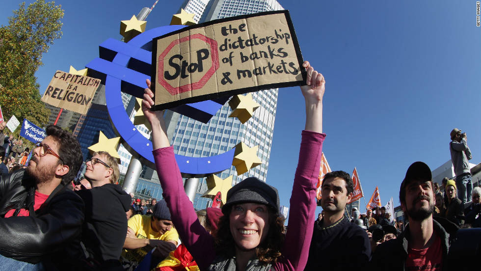 Protesters gather in front of the European Central Bank in Frankfurt, Germany, on Saturday. Protesters also marched in other major cities, including the country's capital, Berlin. The central site for the international movement, United for Global Change, said 951 cities in 82 countries will take part in the rallies.