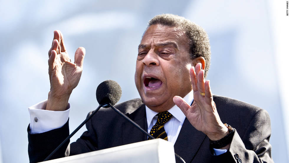"Former U.N. ambassador, former Atlanta mayor and civil rights leader Andrew Young speaks during the dedication.  Young said King was sensitive about his small stature, as he stood only 5 feet 7 inches. ""Now he's 30 feet tall, looking down on everybody,"" Young said."