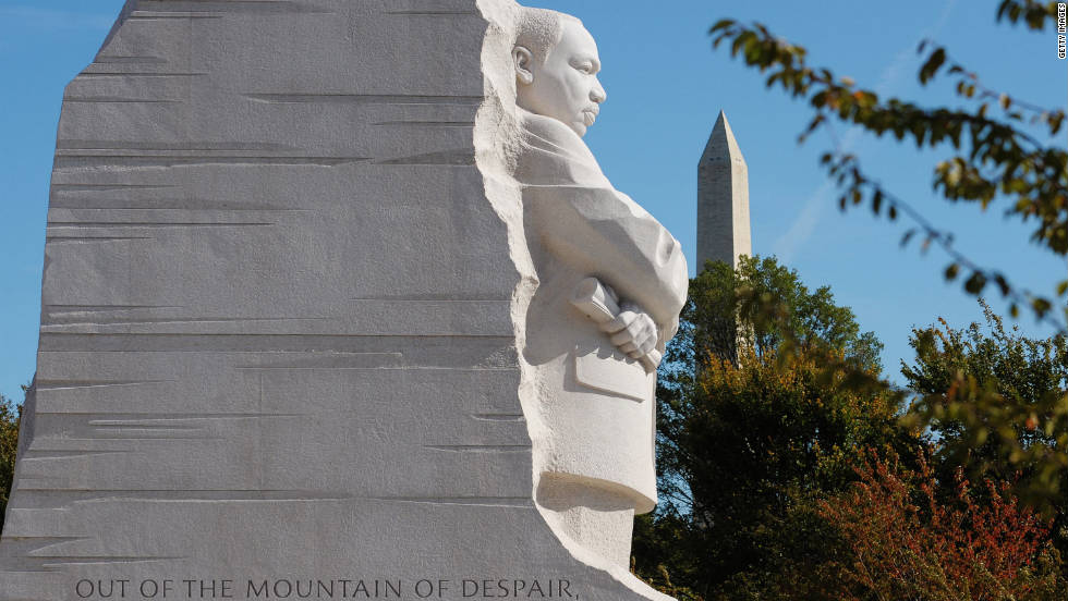 "The memorial site, which features a striking 30-foot statue of King gazing out over the Tidal Basin, lies between the Lincoln Memorial and the Jefferson Memorial on the National Mall. The statue, representing a ""Stone of Hope,"" sits forward from a ""Mountain of Despair."""