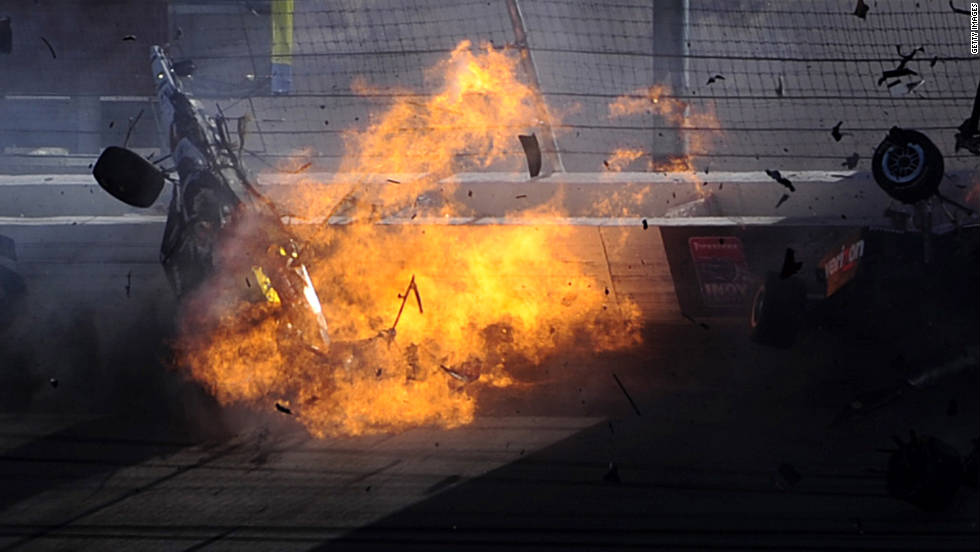 Racing vet Dan Wheldon's car bursts into flames in a multi-car wreck during the Las Vegas Indy 300 on Sunday, October 16. Wheldon, 33, was killed.