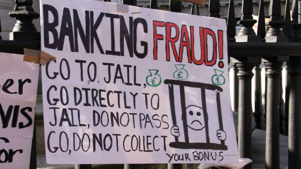 Anti-banking poster at the Occupy London tent village outside St Paul's Cathedral.