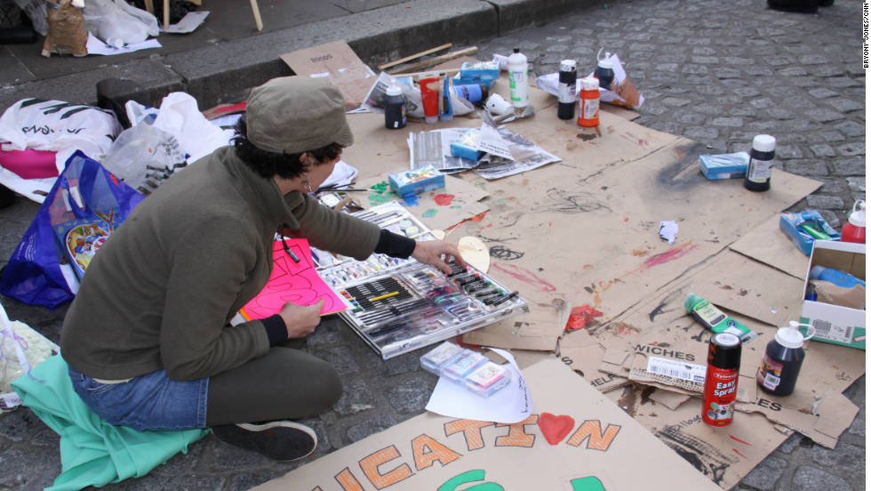 A protester makes banners at the Occupy London demonstration at St Paul's Cathedral.
