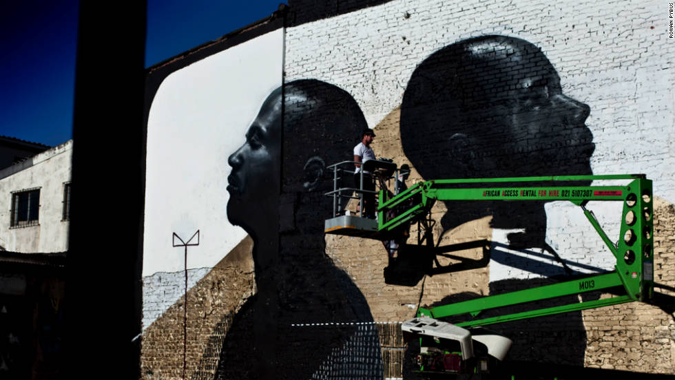 Street artist, Freddy Sam, says his murals are transforming the run-down suburb of Woodstock in Cape Town