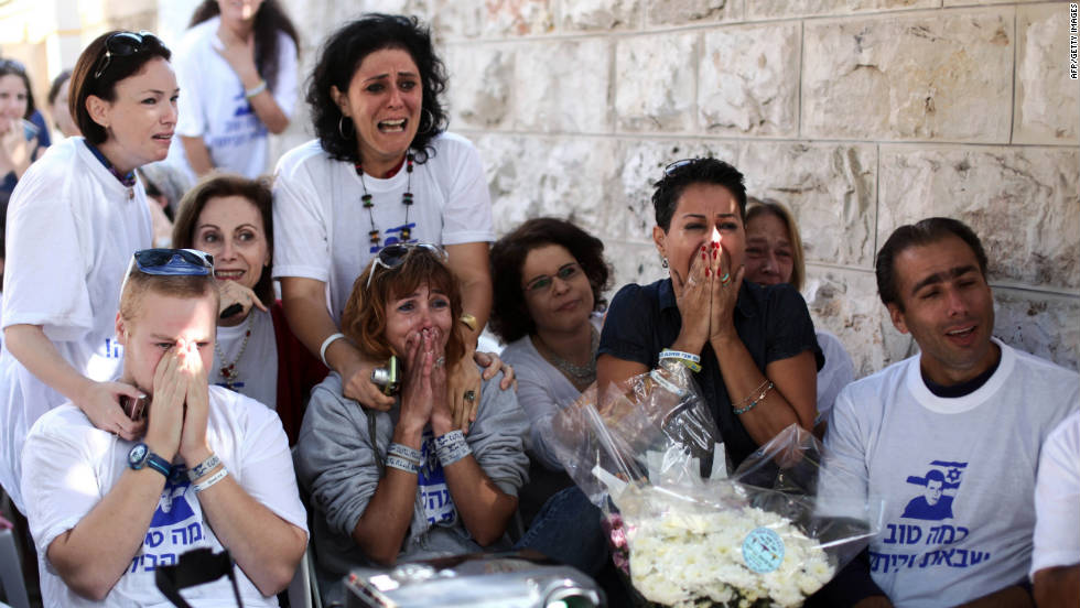 Supporters of Shalit celebrate his release at his family's protest tent outside the prime minister's residence in Jerusalem.