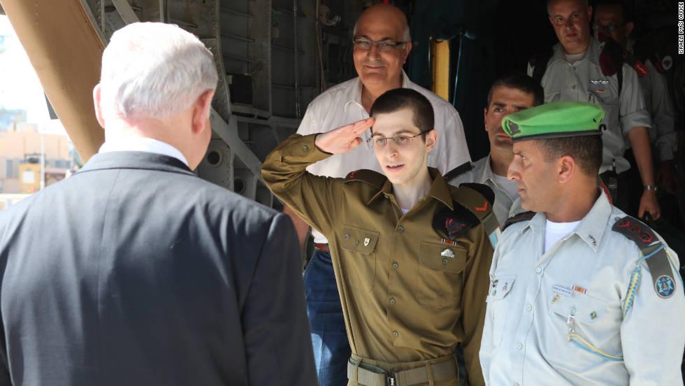 Shalit salutes Israeli Prime Minister Benjamin Netanyahu on Tuesday.