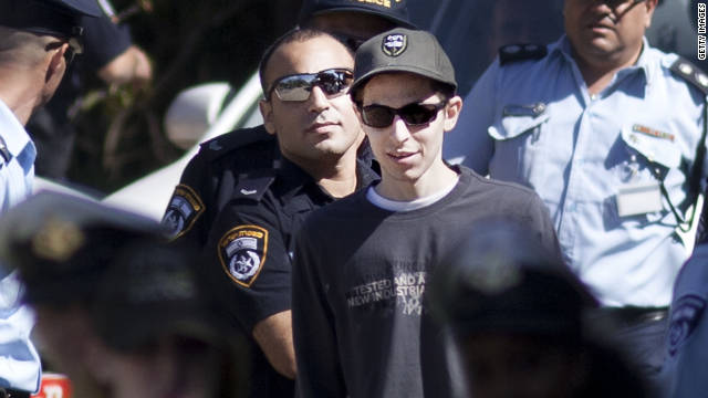 Gilad Shalit, freed after five years as a captive of Hamas in Gaza, walks outside his home Wednesday in Mitzpe Hila, Israel.