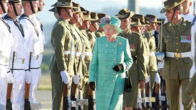 Queen Elizabeth II speaks to members of the armed forces as she arrives in Canberra on October 19.