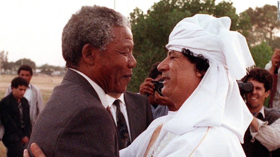 Nelson Mandela, then president of the South African National Congress, greets Gadhafi in Tripoli in May 1990.